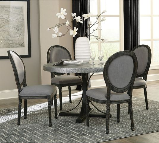 Round, hammered metal top dining table