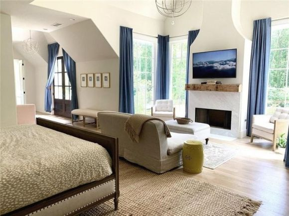 Bedroom with fireplace