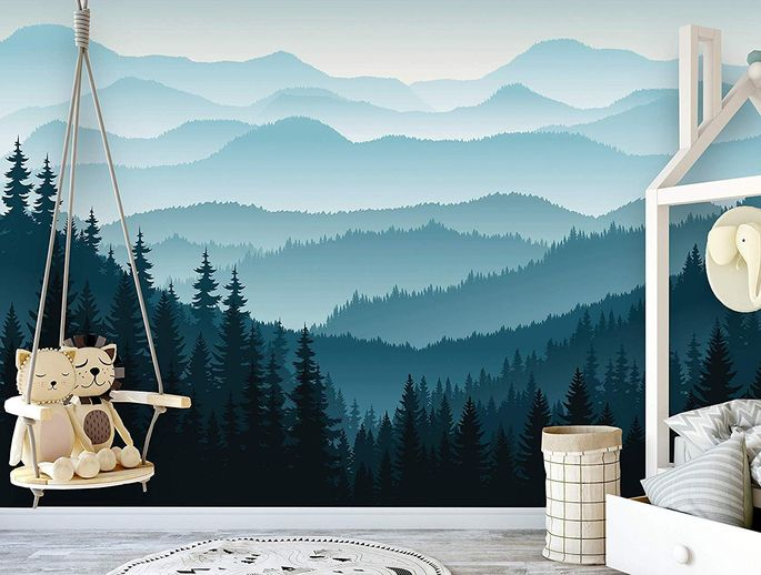 A peel-and-stick ombre mountain mural is a snap to arrange.