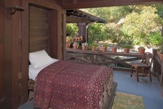 One of five Murphy beds on the outdoor sleeping porch