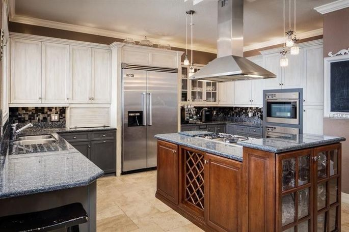 Kitchen with granite counters and travertine flooring