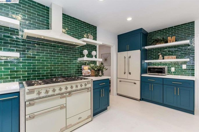 Kitchen featuring bright Moroccan tile
