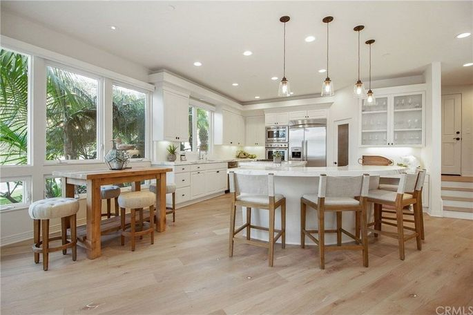 Chef's kitchen with marble counters and casual dining space