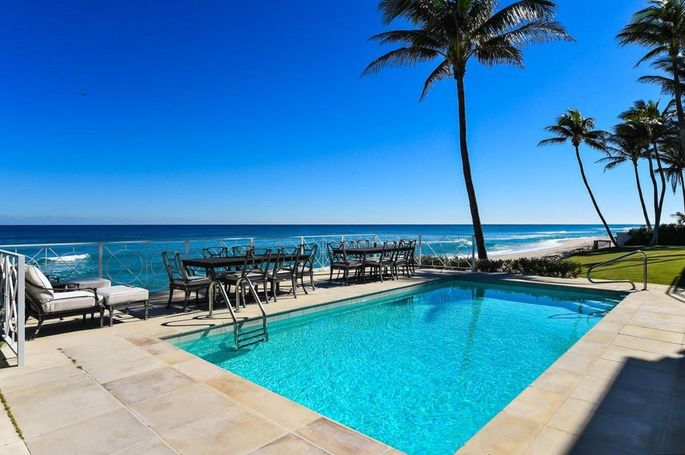Pool and patio with beach views