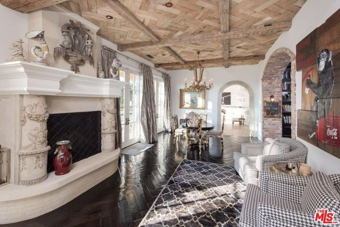 Antique fireplace and imported ceiling