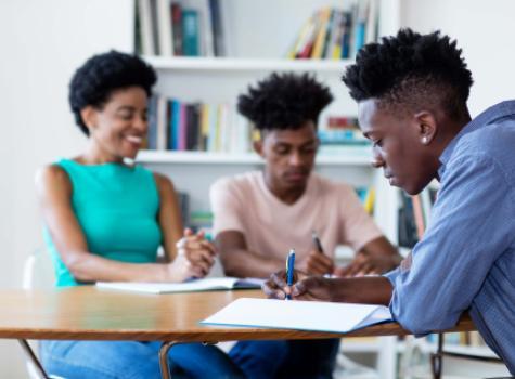 Black Students Doing Work at Desk