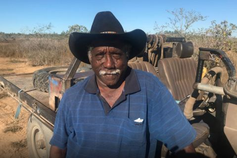 Photo of Seven Emu Stattion owner Frank Shadforth standing in front of bush vehicle in outback