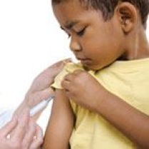 Aboriginal child receiving an injection.vaccination