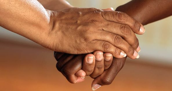 two Aboriginal hands holding
