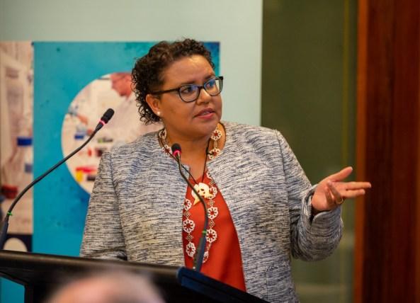 Associate Professor Jaqui Hughes standing at a lecturn