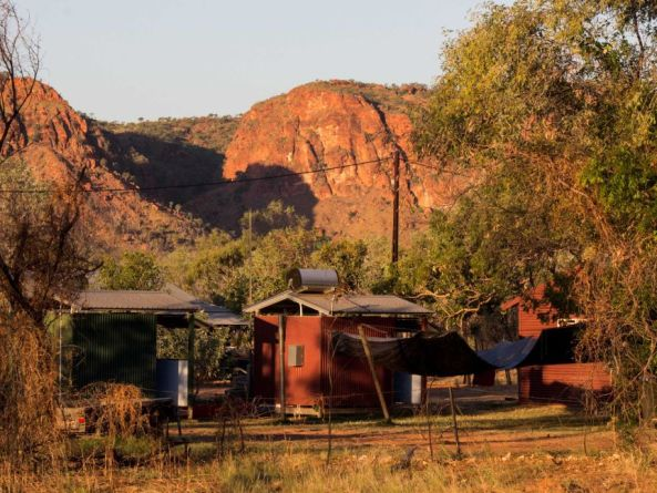 WA remote community buildings against bald rock hills