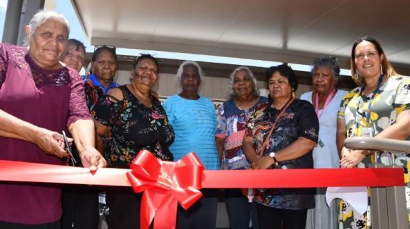 9 Aboriginal women cutting red ribbon to Mt Isa Hospital family rooms