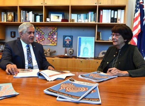 Minister Ken Wyatt & Pat Turner sitting at a desk with draft CTG agreement