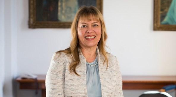portrait photo of Professor Helen Milroy, background is an office