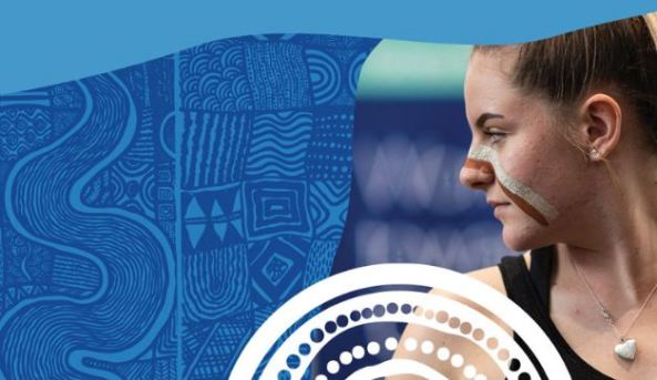 Aboriginal woman with Aboriginal face paint looking sideways against a background of blue and white Aboriginal dot and line painting