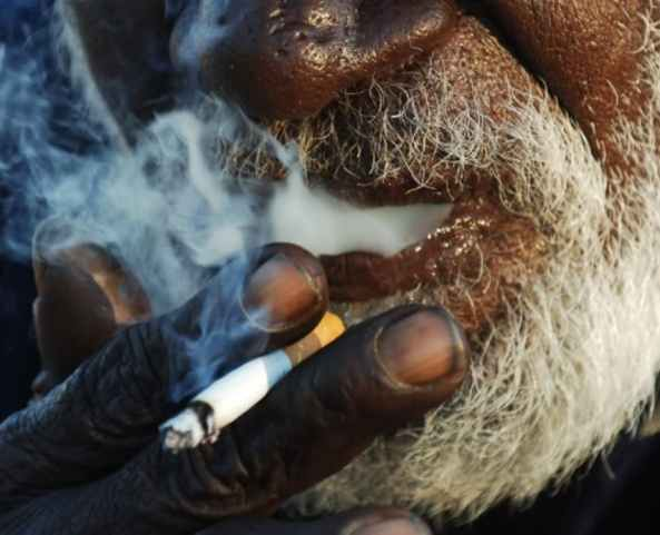 elderly Aboriginal man smoking