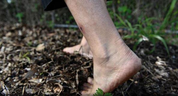 bare feet walking across soil