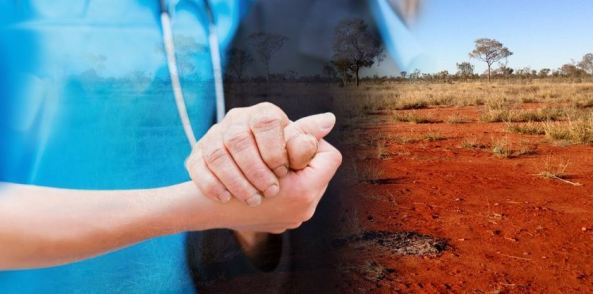 overlapped image of health professional torso with stethoscope holding hand of person against red dusty grasslands