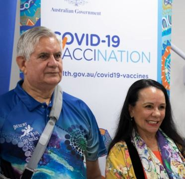 Ken Wyatt MP & Linda Burney in front of COVID-19 Vaccination sign after getting vaccine at Winnunga