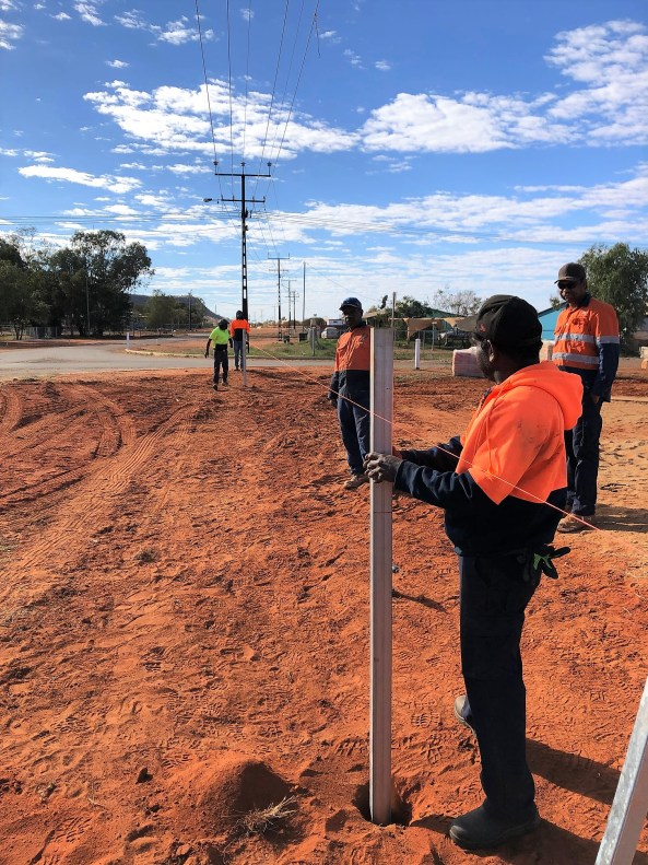 5 Aboriginal workers in high-vis building fence in Laramba community NT