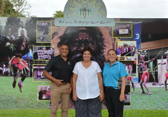 photo L–R: Tony Marten (owner & Managing Director at ATW), Wendy Burke (Director of Health Services at Wuchopperen), Rachael Ham (Deputy CEO at Wuchopperen) standing in front of Wuchopperen banner