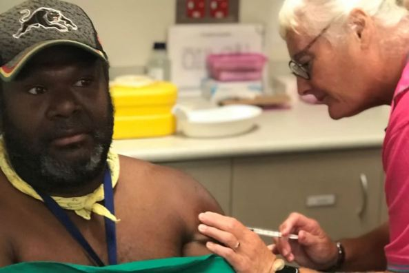 Saibai Island (Torres Strait Islands) councillor Conwell Tabuai being vaccinated by nurse Sue Bowler