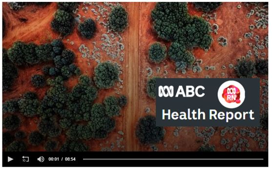 aerial photo of red outback land with dusty track & green & silver desert shrubs, overlaid with text 'ABC Health Report' & ABC RN logo 'ABC symbol RN' superimposed on pink orange voice bubble