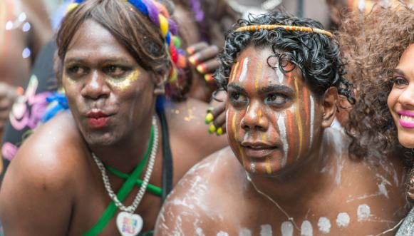 faces of 3 Aboriginal people with rainbow colours