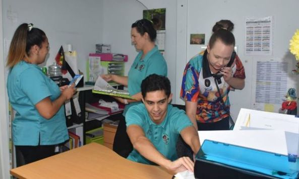 Megan McIntosh & Tara Price with (front) Brock Kinchela & Lucy Ridds in one of Armajun Aboriginal Health Service office