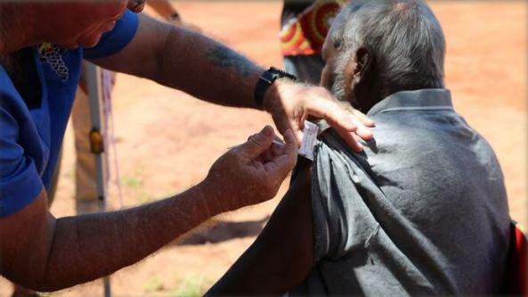 A Beagle Bay (WA) community member receives a coronavirus vaccine in April, 2021