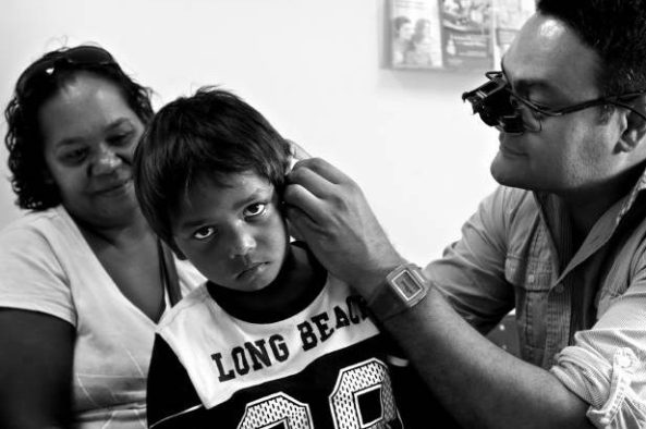 On Duty: Kelvin Kong treats a patient in Broome in 2015. Picture: Simone De Peak.
