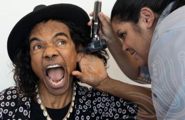 Comedian Sean Choolburra receiving one part of his 715 health check