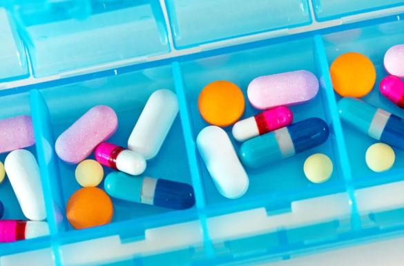 blue multiple pill holder each compartment with 6 different coloured tablets