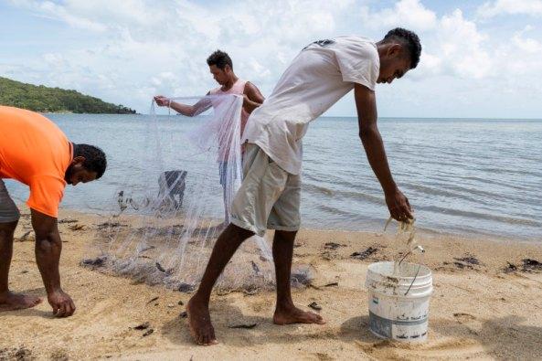 Yarrabah residents casting netting for prawns in far north Queensland. Credit: Rhett Wyman.