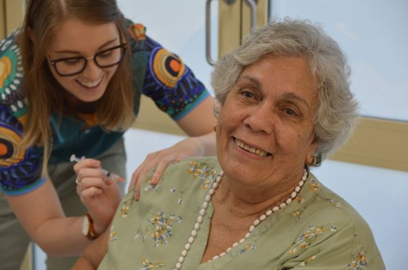 Wuchopperen Board Member Maureen Mossman receiving vaccination