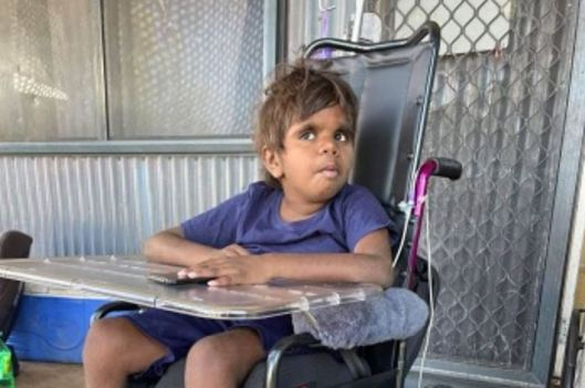 Seven-year-old Kelvina Benny in her wheelchair