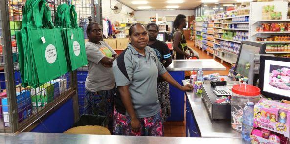 Aboriginal staff at checkout in Barlmarrk Supermarket