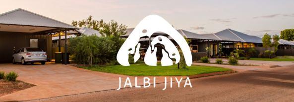 street of houses overlaid with white Jalbi Jiya logo
