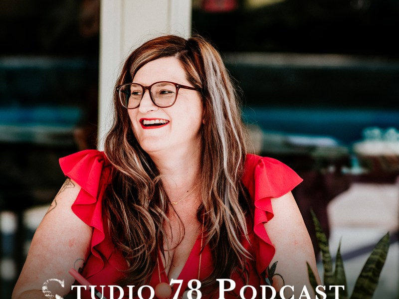 Image of Nicole Stevenson of Dear Handmade Life. She has on a tomato red shirt with ruffles sleeves. She's sitting at a table with a Tombow marker in her had.
