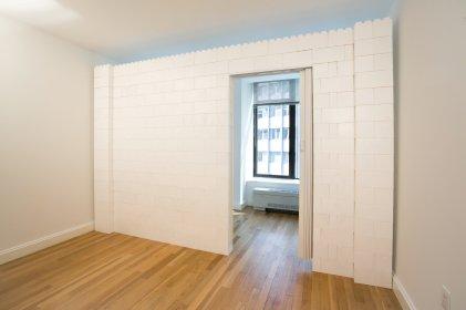 "Apartment Wall With Door Using ""Lego"" Bricks"