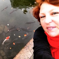 Peggy meets her match, the koi at Nakajima point