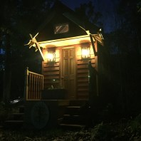 The tiny house lit up on a cool fall night <3