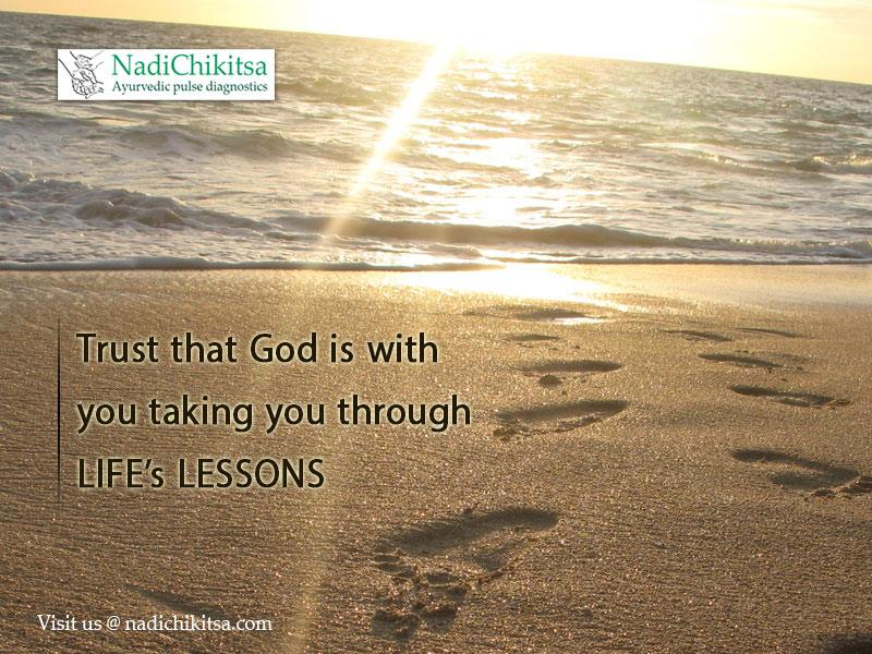 Beach Sand with foot prints saying trust that God is taking you through life's lessons