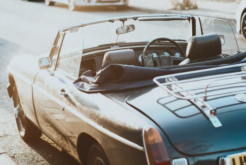 self-assignments , photograph of convertible car in sunlight