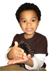 boy doing sign language