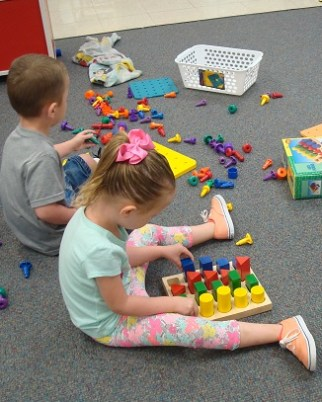 girl playing with peg board
