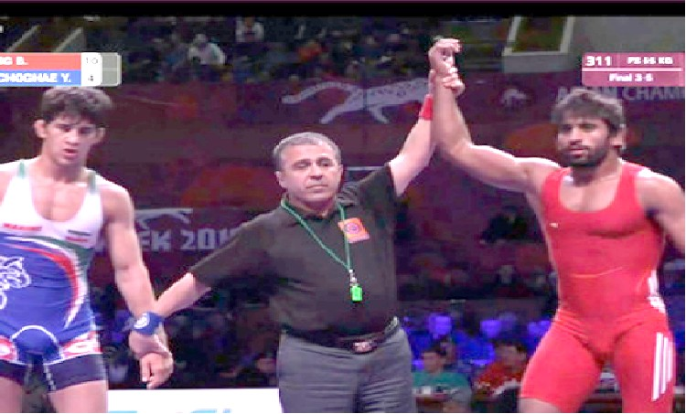 Bajrang Punia, Vinod Kumar win bronze medals