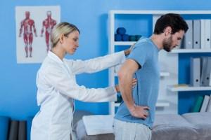 Doctor examining a spinal cord injury