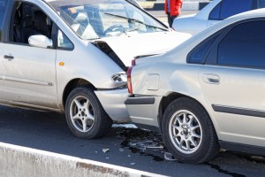 Two cars in a car accident on street.  Insurance case - closeup damaged automobiles after collision in city.