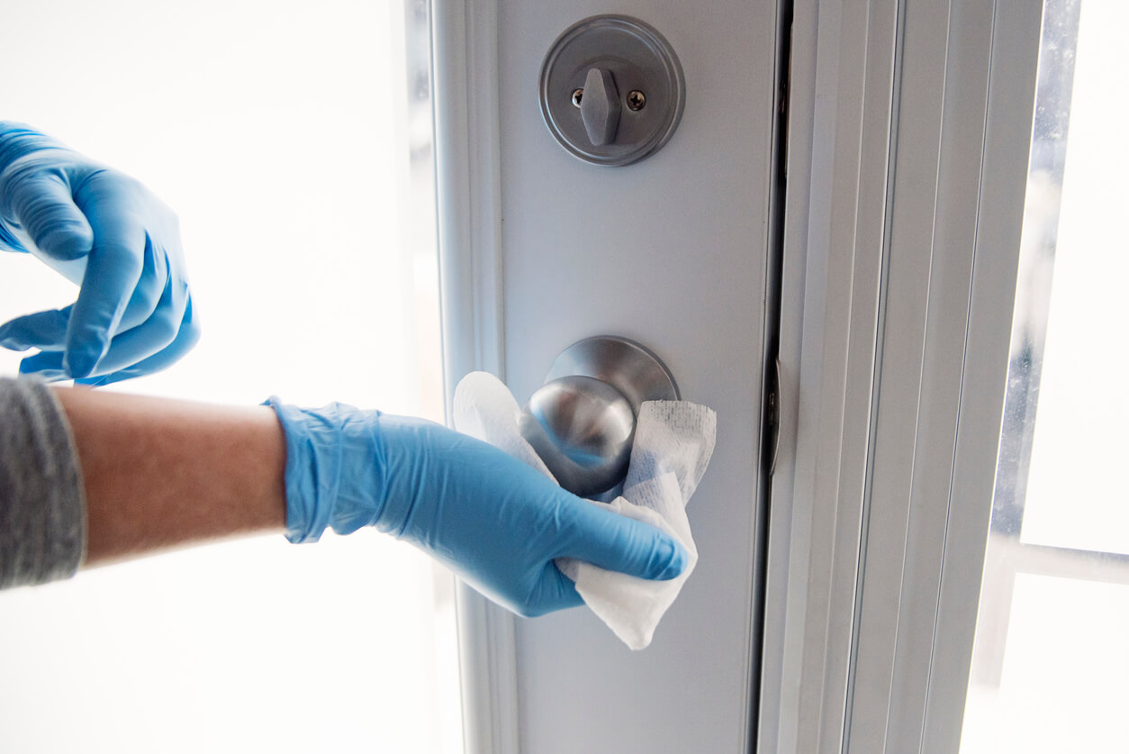 Wiping down the doorknob.
